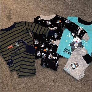 3 sets of baby boy pajamas size 12m.
